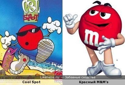Персонаж-талисман торговой марки 7 UP по имени Cool Spot и красная конфета M&M's