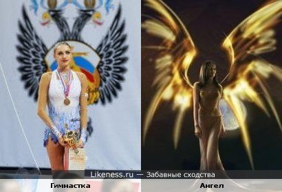 Гимнастка на фоне герба похожа на ангела