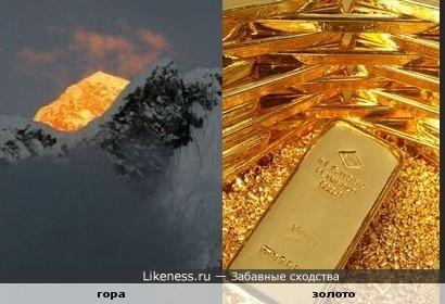 Вершина горы в индийских Гималаях, освещенная солнцем, похожа на золото