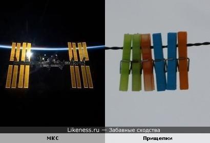 Международная космическая станция на фоне атмосферы Земли похожа на прищепки