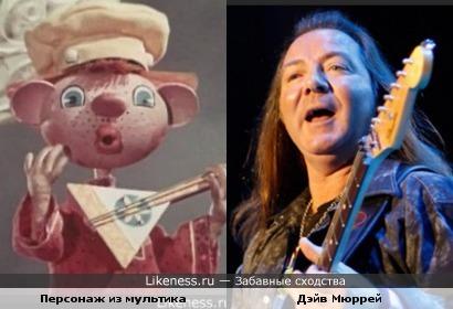 "Гитарист Iron Maiden Дэйв Мюррей и персонаж из м/ф ""Бурёнка из Маслёнкино"""
