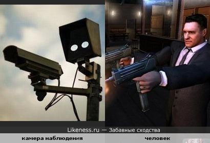 Камера наблюдения похожа на злодея с автоматом